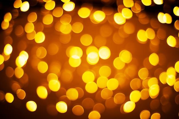 黄色とオレンジ色のライトのボケ味の背景、クリスマスと新年のbakcground