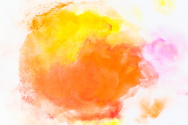 黄色とオレンジの水彩画がこぼれる 無料写真