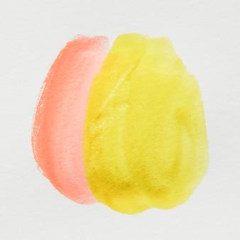 白地に黄色とオレンジ色の水彩スポット