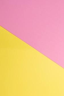 Желтый и розовый вертикальный бумажный фон в мягких пастельных тонах