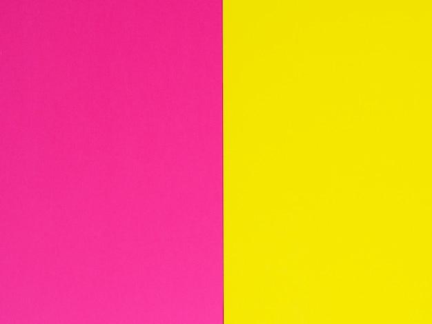 Желтый и фиолетовый. двухцветный бумажный фон. копировать пространство, ftal lay