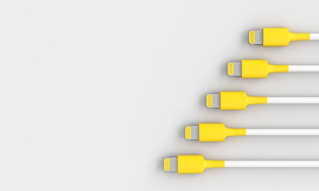 Желтый и белый соединительный кабель usb на сером фоне.