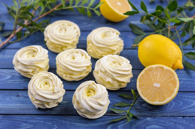 Yellow, apple marshmallow with lemon on a bright blue background.