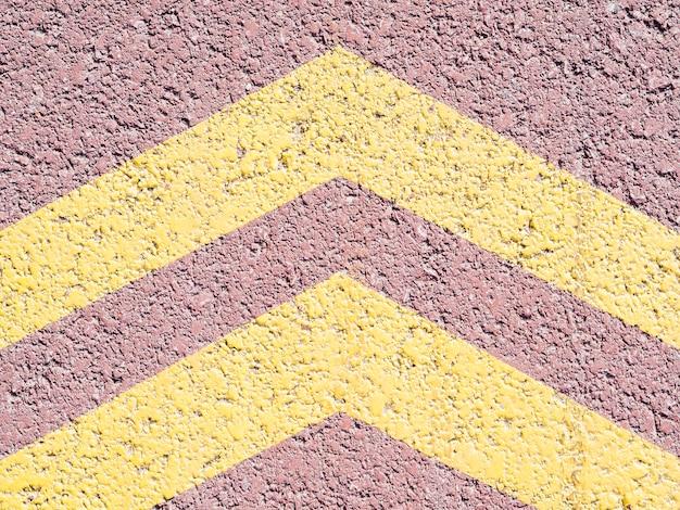 Yellow arrows on asphalt