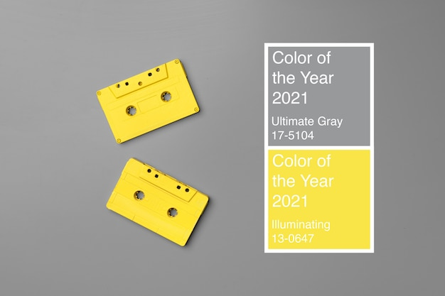 Yellow audio cassettes on gray background top view