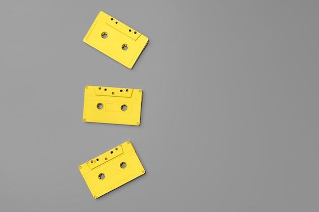 Yellow audio cassettes on gray