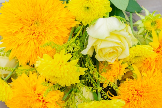Yellow autumn bouquet of vibrant flowers close up