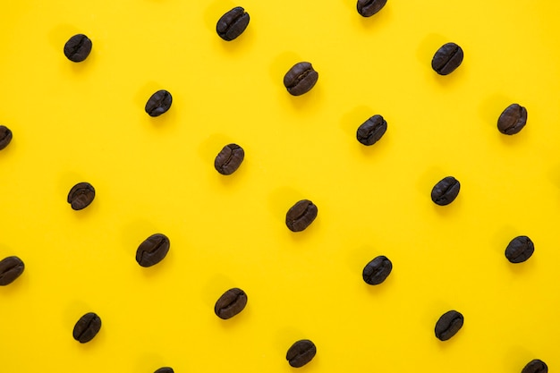 Yellow background with coffee beans