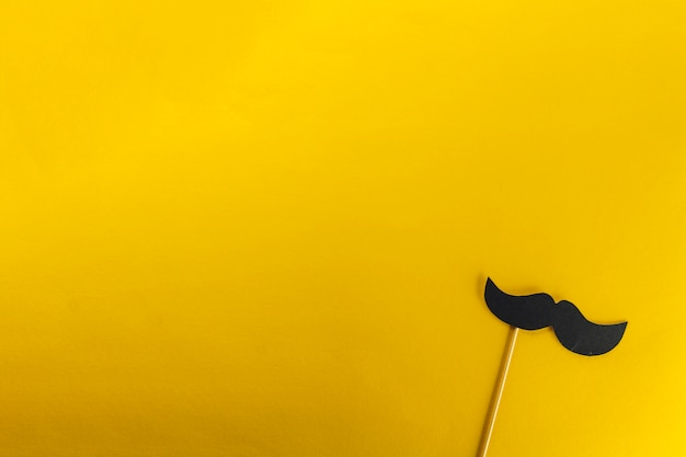 Yellow background with decorative fake mustache