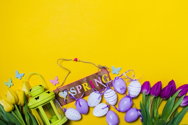 Yellow background with decorative spring items