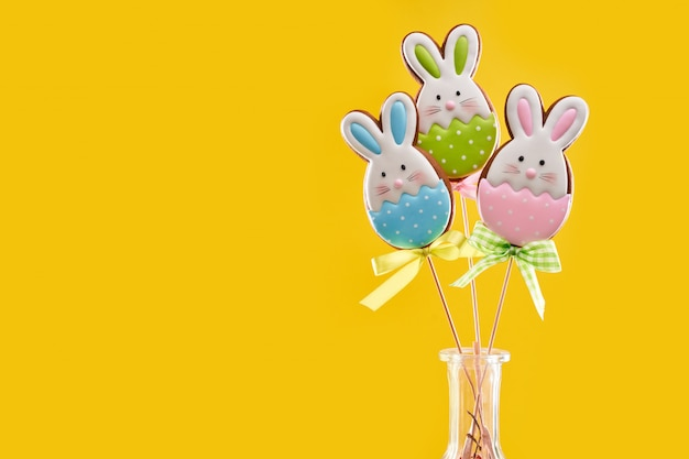 Yellow background with easter gingerbreads on sticks