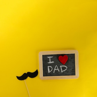 Yellow background with slate and gift box for father's day