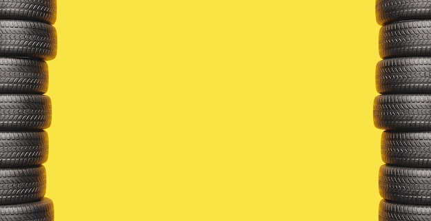 Yellow background with two columns of tires on the sides and space for text. 3d rendering