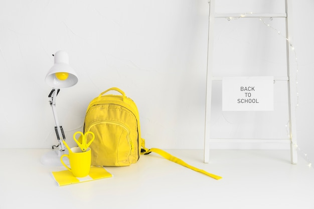 Yellow backpack in creative teenage workspace