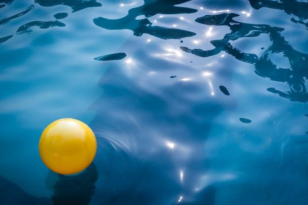 Yellow balloon in swimming pool