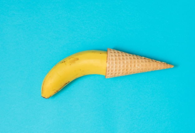 Yellow banana in a waffle cone. male problems, impotence, bad erection concept