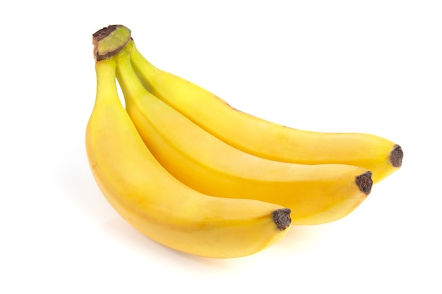 Yellow bananas isolated on white surface