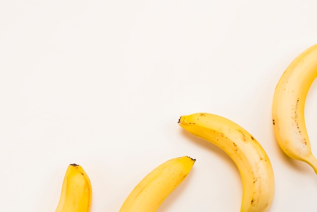 Yellow bananas on white background