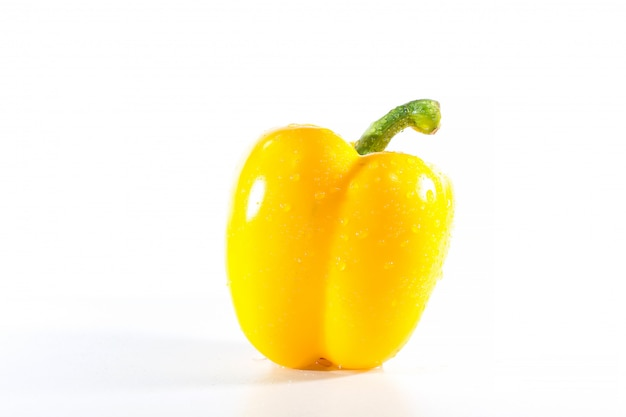 Yellow bell peppers on white