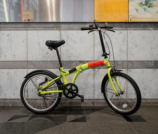 Yellow bicycle with black and red details