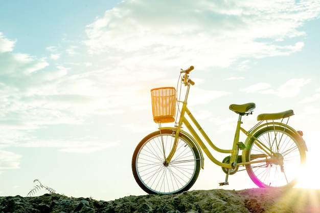 Yellow bike and sunset in the evening of winter with key copy space