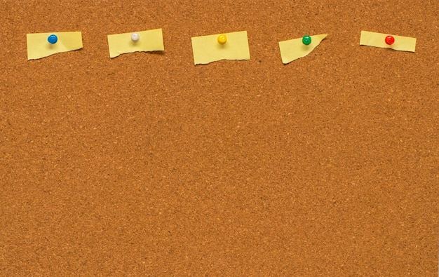 Yellow blank note on cork board with clipping path.
