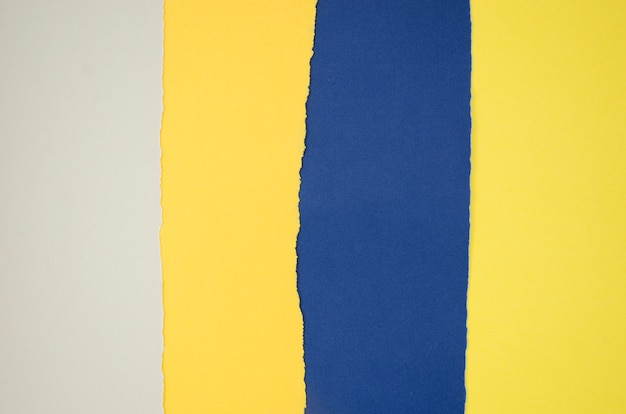 Yellow and blue abstract composition with colour papers