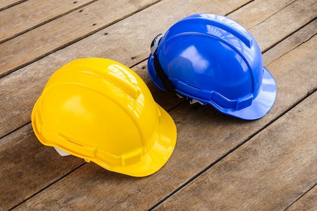 Yellow, blue hard safety helmet construction hat for safety project of workman as engineer or worker