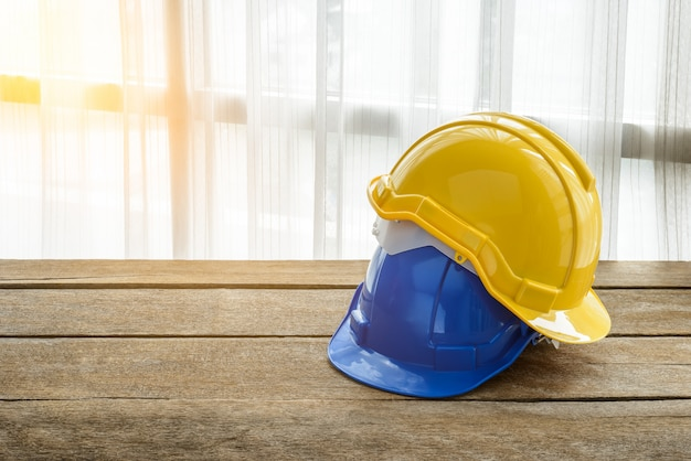 Yellow, blue hard safety helmet construction hat for safety project