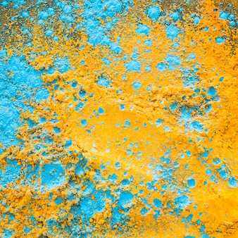 Yellow blue powder on table