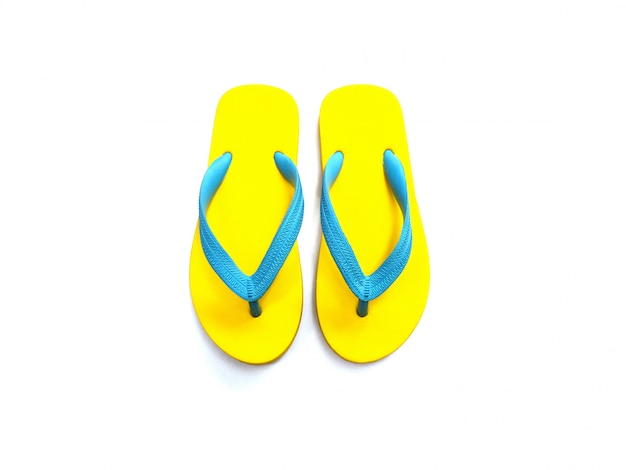 Yellow and blue rubber flip flop shoes
