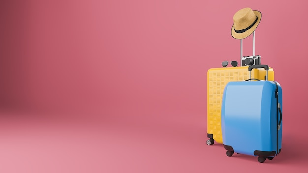 Yellow and blue suitcase with sun hat and glasses, camera, travel concept