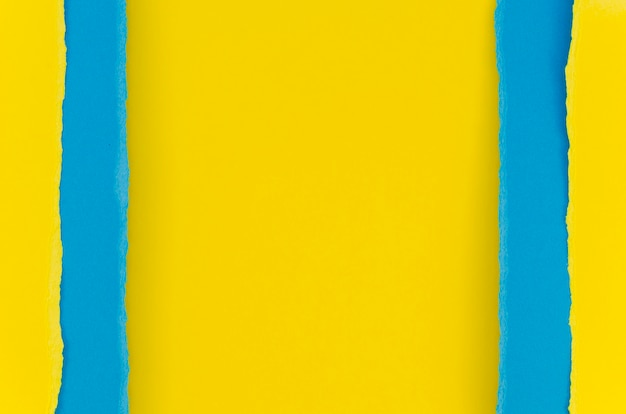 Yellow and blue torn paper
