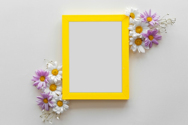 Yellow border frame decorated with beautiful flowers against white surface