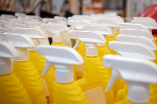 Yellow bottles in the store. sprayers for water. beautiful sprayers are on the supermarket shelves