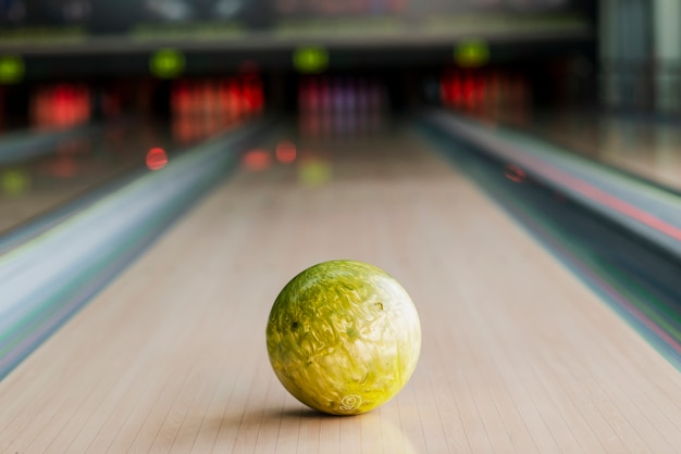 Yellow bowling ball on the alley