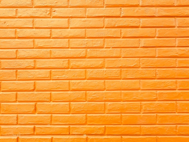 黄色のレンガブロック壁、抽象的な黄色のセメントテクスチャ背景