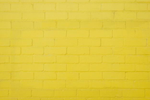 노란 벽돌 벽 배경 질감