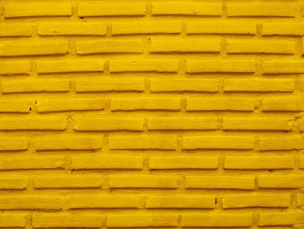 Yellow brick wall background.