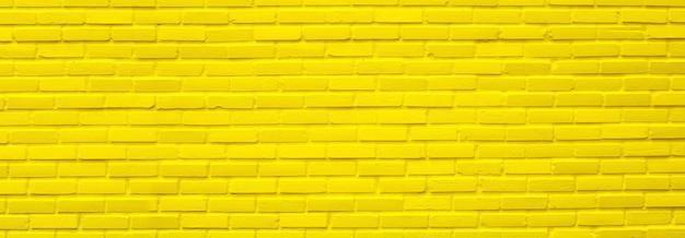 Желтая текстура кирпичной стены для фона.