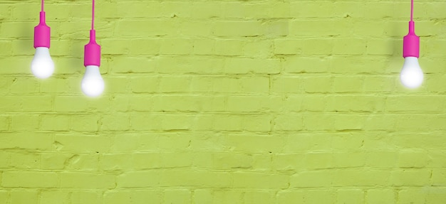 Yellow brick wall with light bulbs. creative copy space for your text or image. banner format