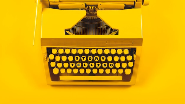 Yellow bright typewriter as symbol for writing, new ideas, creativity and storytelling
