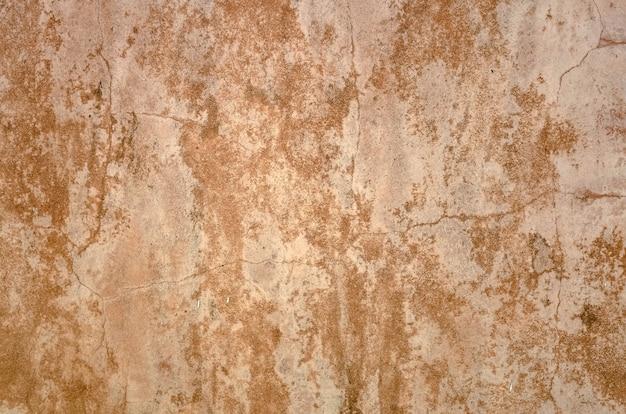 グランジテクスチャと黄褐色の汚れたカビの生えた壁の背景