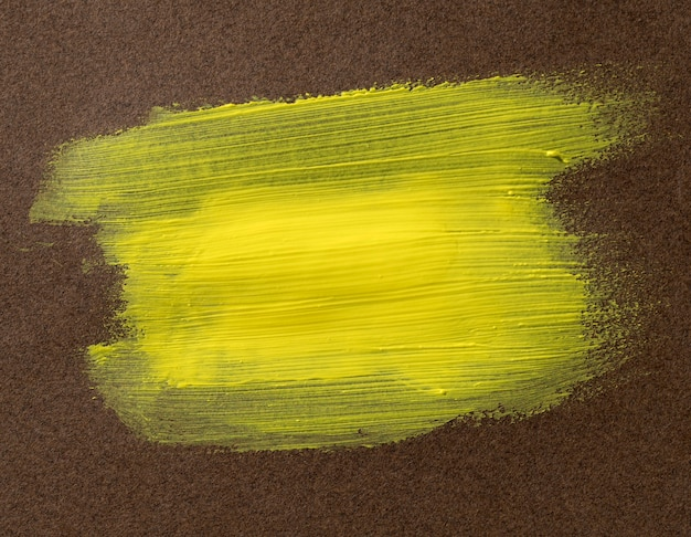 Yellow brush stroke on textured background
