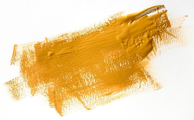 Yellow brush stroke on white background