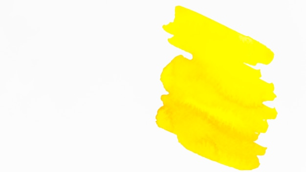 白い背景に分離された黄色のブラシストローク
