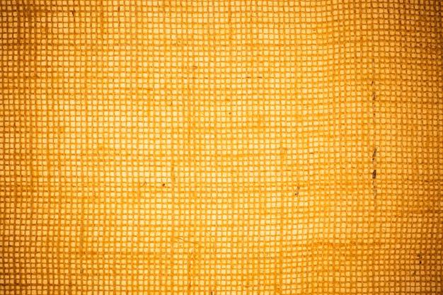 Yellow burlap fabric texture background.