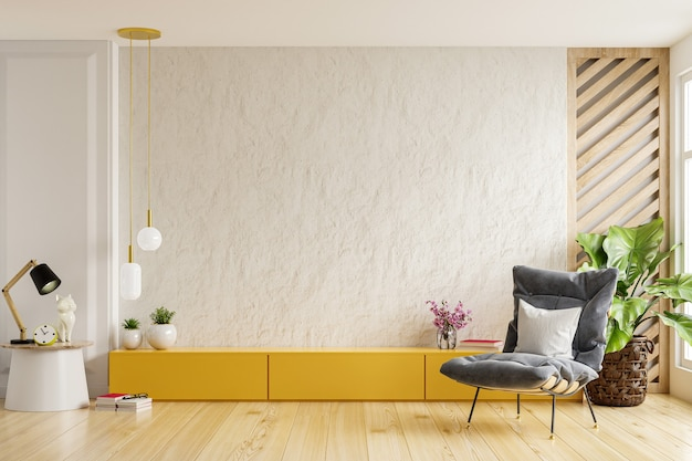Yellow cabinet for tv on the white plaster wall in living room with armchair,minimal design.3d rendering