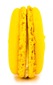 Yellow cake macaron or macaroon isolated, sweet and colorful dessert