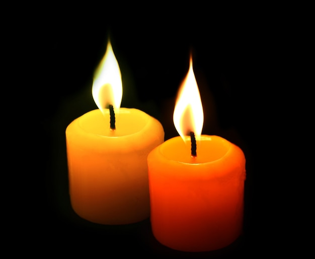 Yellow candles on black.